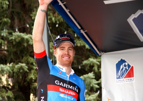 Tyler Farrar steps onto the podium in Telluride to receive the first 2012 USA Pro Challenge yellow jersey