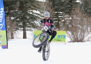 Chad Melis shows even snow bikes can do wheelies