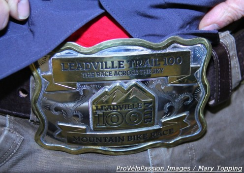 Kent Eriksen unveils his Leadville 100 belt buckle; it's larger because he and Katie completed the course in under nine hours