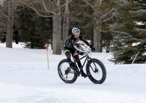 Rebecca Gross taming her snow bike beast