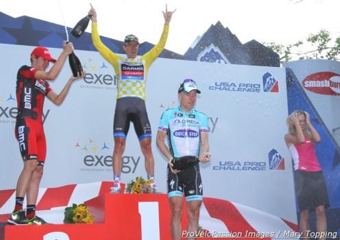 2012 USA Pro Challenge final podium champagne frenzy: Tejay van Garderen 2nd, Christian Vande Velde 1st, Levi Leipheimer 3rd (l to r)