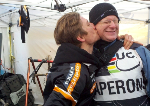 Russell Stevenson's joy after becoming a cyclo-cross masters world champion extended to the UCI chaperone (photo by David Weber)