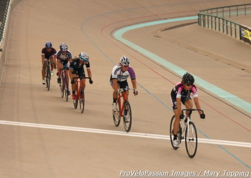 Jennifer Triplett on the front of a women's field during a Friday night race at the Colorado Springs Velodrome