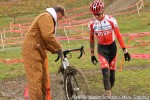 """Bruce Hecht checks over Gage Hecht's """"B"""" bike at thepit."""