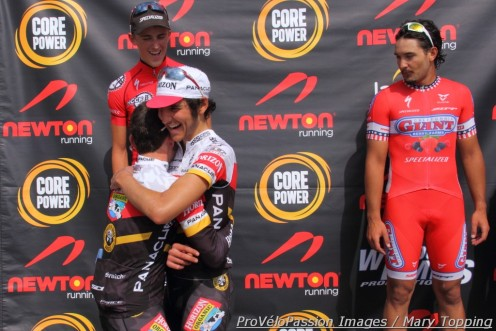 Fabio Calabria bear hugs Emerson Oronte with Gage Hecht (left) and David Kessler on the podium
