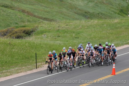 Early in lap one of the road race the women's pro-1-2 and Masters 35+ groups rode as one pack