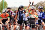Abby Mickey and Mara Abbott high five at the start, Margell Abelcenter