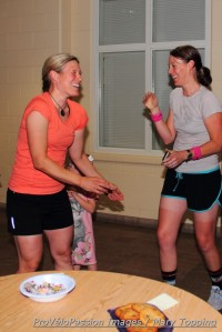 Katie Compton and Katie Macarelli practice good sportswomanship before the bake-off