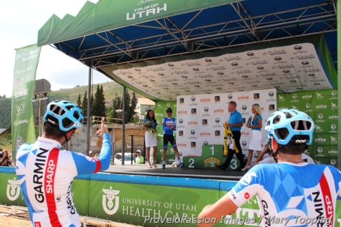 Alex Howes and Phil Gaimon watch Tom Danielson receive the 2014 Tour of Utah yellow jersey on Powder Mountain