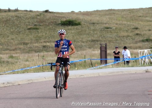 Jeremy Powers zips up for victory salute at KickIt Cross