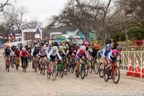 Arly Kemmerer guides the elite women after the start of 2015 cyclocross nationals. Katie Compton will slot into the first ten riders to begin lap one.