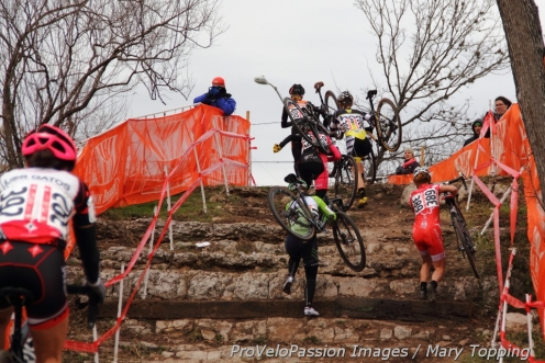 Kristin Weber at the front of the early leader's group in lap 1 on the short limestone stairs