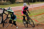 Melissa Barker passes a lapped rider while chasing Kristin Weber in lapfour