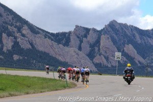 Reduced men's pack chases Michael Burleigh into the Flatirons