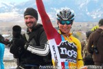 Meredith salutes after winning a muddy Coloradorace
